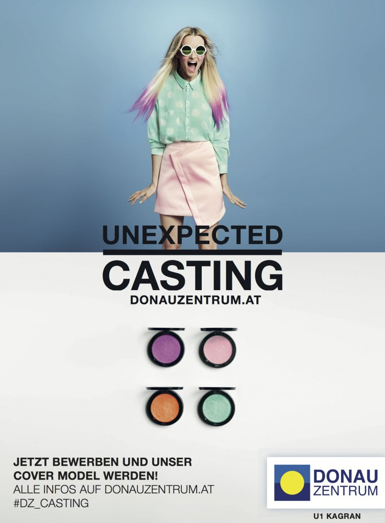 """A print ad for the #dz_casting hashtag campaign running on Walls.io. The ad shows a woman in a pale green blouse and a pale green skirt, and the copy reads """"Unexpected Casting: donauzentrum.at"""". Below the copy there are four colourful pots of eyeshadow."""