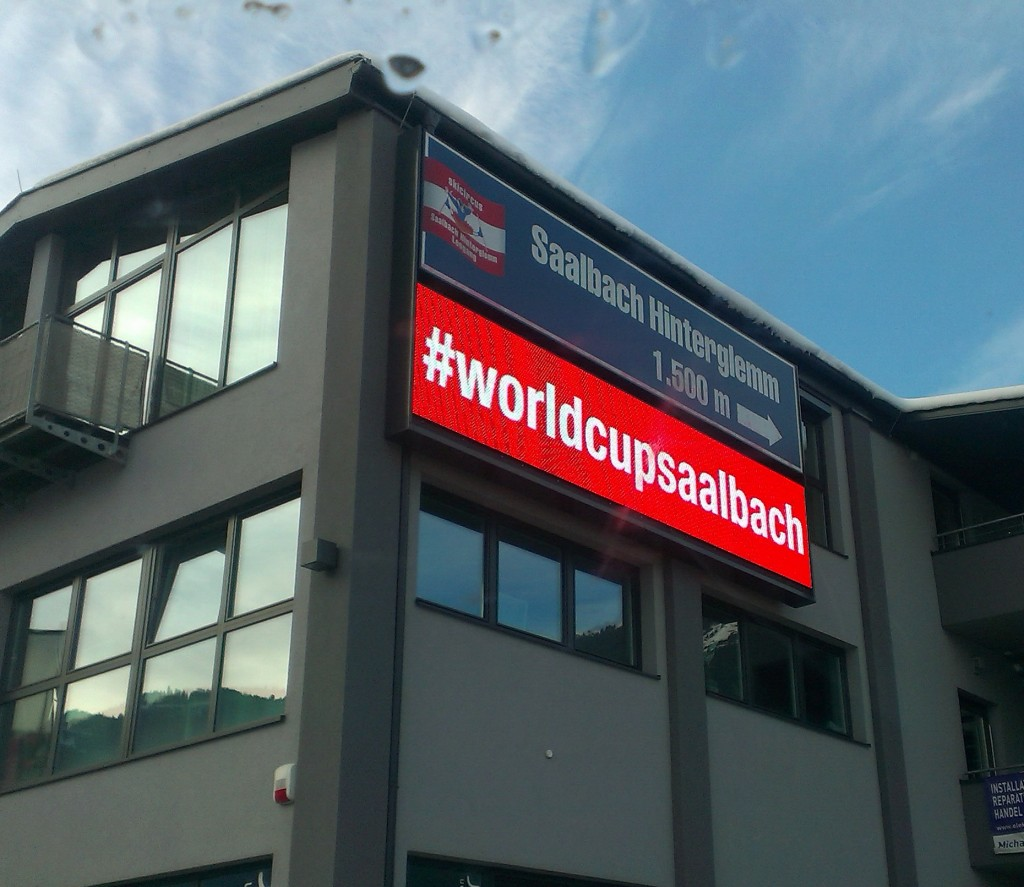 A photo of a building ad, promoting the official hashtag #worldcupsaalbach