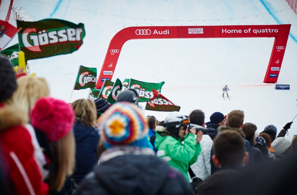 The photo shows a huge crowd around the finish line at ski world cup in Saalbach-Hinterglemm.