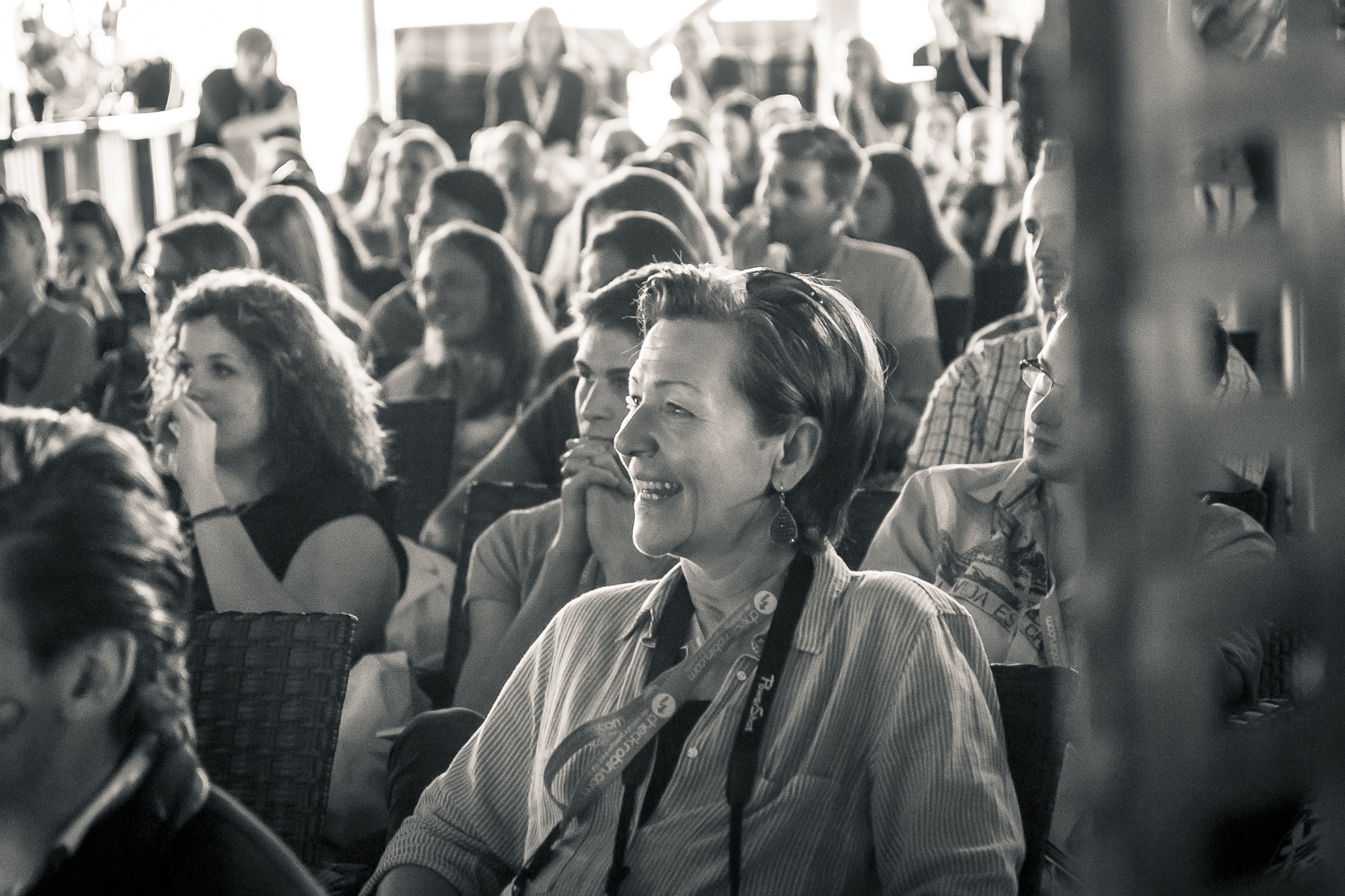 A b/w photo of the crowd enjoying TEDxDonauinsel 2014, photo taken by Manuel Gruber