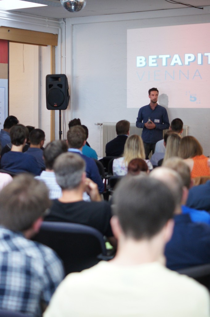 Man speaking in front of the audience at betapitch | Vienna event at Sektor5 in 2014