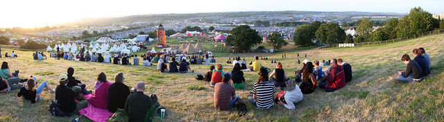 A panoramic view of the are of Glastonbury Music Festival, people milling around the campsites, taken in 2009 by Brian Marks