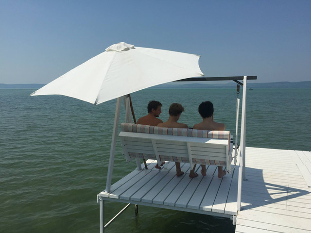 Three Walls.io and Swat.io programmers chilling out on a swing by Lake Balaton in Hungary