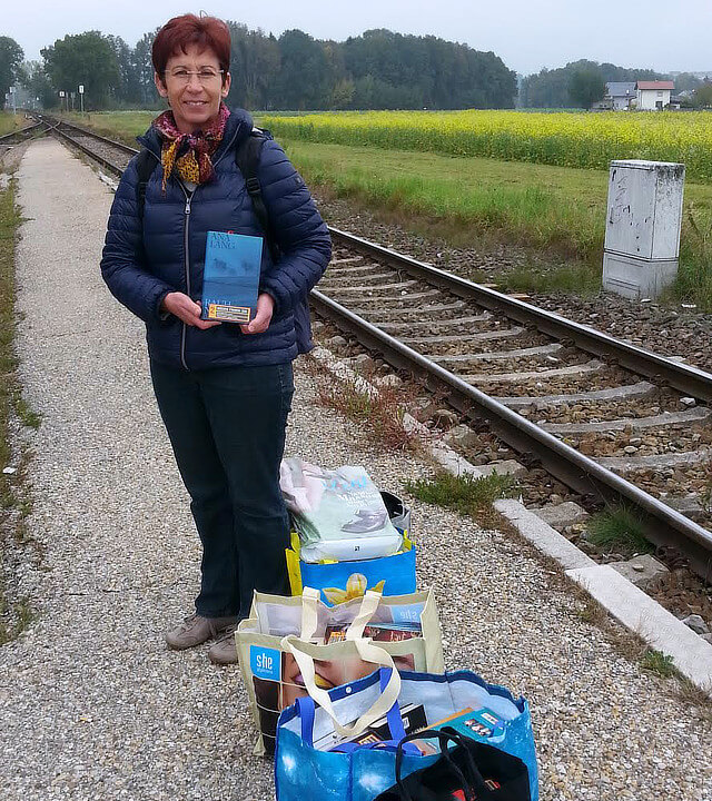 A #buecherfahrenzug librarian waiting for the train.