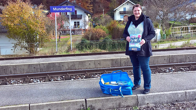 A #buecherfahrenzug librarian in Munderfing waiting to place free books on the train.