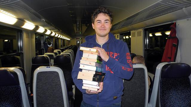 A #buecherfahrenzug librarian distributes free books on a train in Upper Austria.