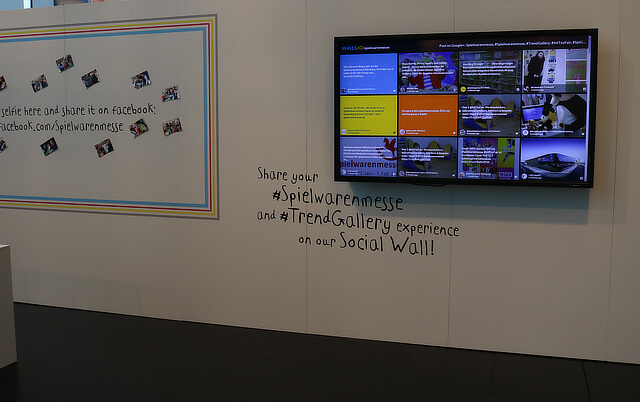Photo of the social wall screen and some prompts for using the hashtag