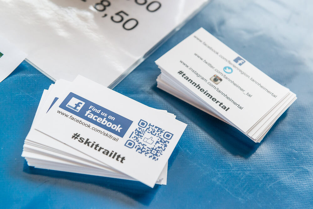 Tannheimer Tal business cards feature their hashtags as well