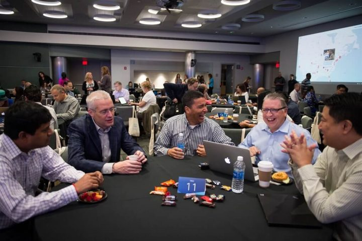 People sitting around a table during Cisco Leader Day in San Jose, California.