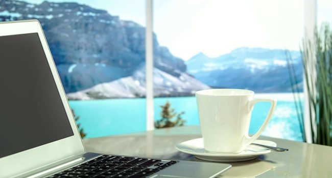 hotel social media marketing ideas laptop, coffee cup and lake view