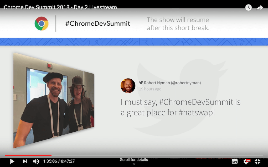 Screenshot from the Chrome Dev Summit live stream on YouTube showing the event's social wall on a big screen with the Walls.io Kiosk theme layout (one post at a time, shown big).