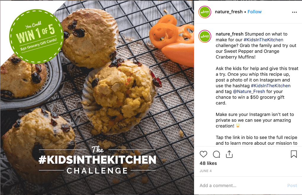 "Instagram post by @nature_fresh, image shows muffins on a cooling rack and overlays for ""The #KidsInTheKitchen Challenge"" and You Could Win 1 of 5 $50 Grocery Gift Cards!"" Post caption: Stumped on what to make for our #KidsInTheKitchen challenge? Grab the family and try out our Sweet Pepper and Orange Cranberry Muffins! Ask the kids for help and give this treat a try. Once you whip this recipe up, post a photo of it on Instagram and use the hashtag #KidsInTheKitchen and tag @Nature_Fresh for your chance to win a $50 grocery gift card.⠀ Make sure your Instagram isn't set to private so we can see your amazing creation! 🌟 Tap the link in bio to see the full recipe and to learn more about our mission to inspire kids to eat more veggies."