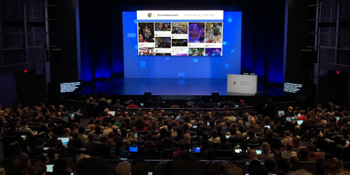 Social media feed display on the stage during Google's Chrome Dev Summit