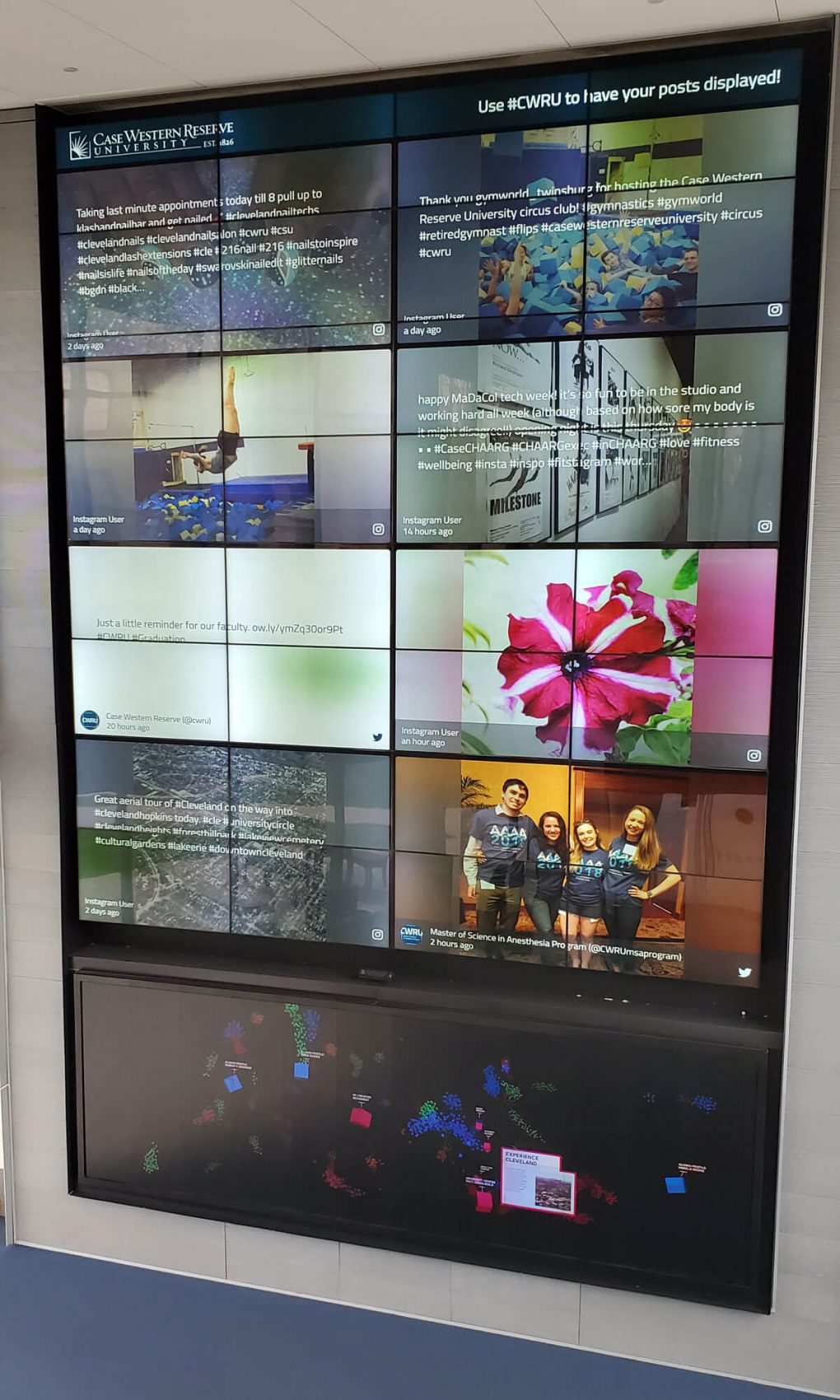 A closer shot of the Tink media wall at Case Western University, showing the social walls on the top part of the wall, called the Beacon.