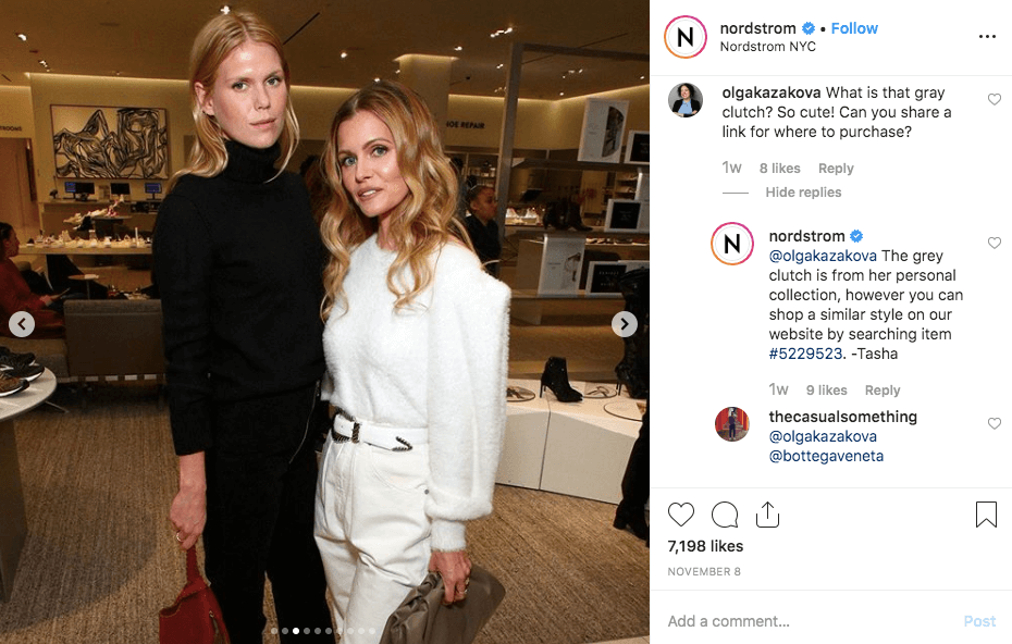 Instagram post by Nordstrom. The photo shows two people at an event, dressed up and posing for the camera. A follower asks about the clutch one of the people is holding and Nordstrom informs them how to get a similar style on the Nordstrom website.