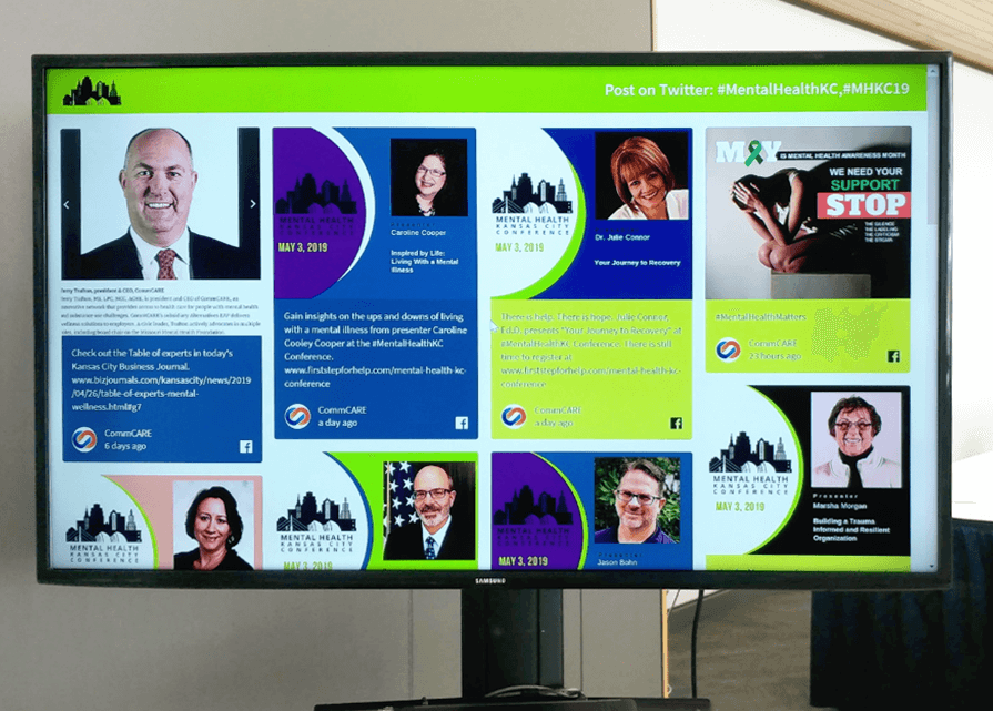 The Mental Health KC social wall, designed in lime green and blue, displayed on a monitor.