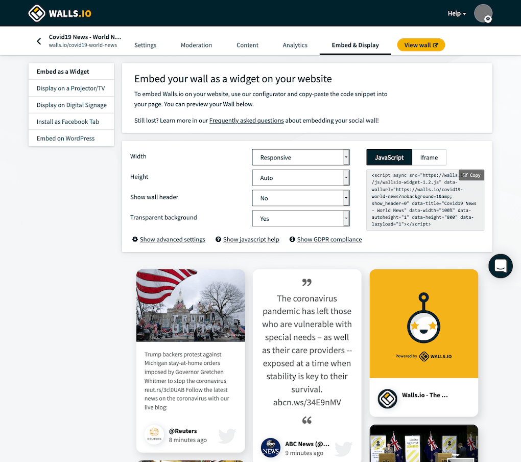 Screenshot of the Walls.io Dashboard's Embed & Display section. It explains how to embed the social wall on any website using a JavaScript embed code that can be copied and pasted. Underneath the settings section for the embed, we see a preview of the social wall,