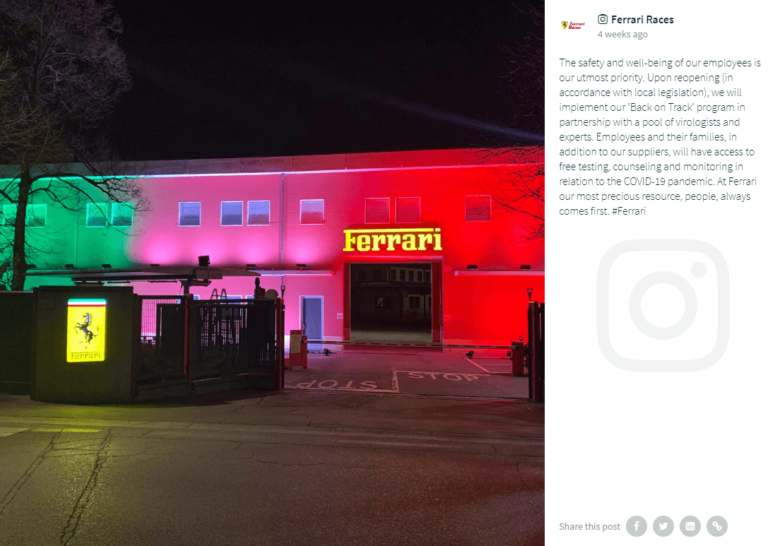 "Instagram post by @FerrariRaces showing a building at night with its front lit up in green, pink and red lights. Above a doorway, the Ferrari lettering shines in yellow neon. In front of the building, the whole Ferrari logo with the black horse is mounted on a wall.  The caption of the post reads: ""The safety and well-being of our employees is our utmost priority. Upon reopening (in accordance with local legislation), we will implement our 'Back on Track' program in partnership with a pool of virologists and experts. Employees and their families, in addition to our suppliers, will have access to free testing, counseling and monitoring in relation to the COVID-19 pandemic. At Ferrari our most precious resource, people, always comes first. #Ferrari"""