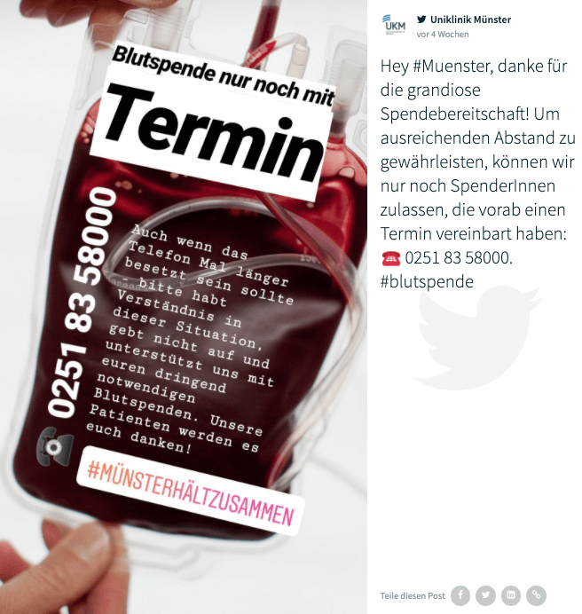 "Twitter post by @UK_Muenster as shown on the social media hub. The image shows a blood bag overlaid with copy (in German) informing potential donors that they will need an appointment to give blood during the COVID-19 pandemic. It also features a phone number and the hashtag #MünsterHältZusammen (meaning Münster is sticking together). The caption is in German and reads: ""Hey #Muenster, danke für die grandiose Spendebereitschaft! Um ausreichenden Abstand zu gewährleisten, können wir nur noch SpenderInnen zulassen, die vorab einen Termin vereinbart haben: ☎️ 0251 83 58000. #blutspende"""