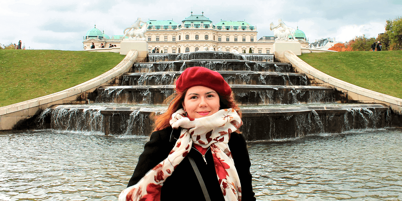 Woman during autumn at the Belvedere palace in Vienna. Featured image for the Vienna Tourist Board Uses Social Media Content to Attract Tourists blog post.
