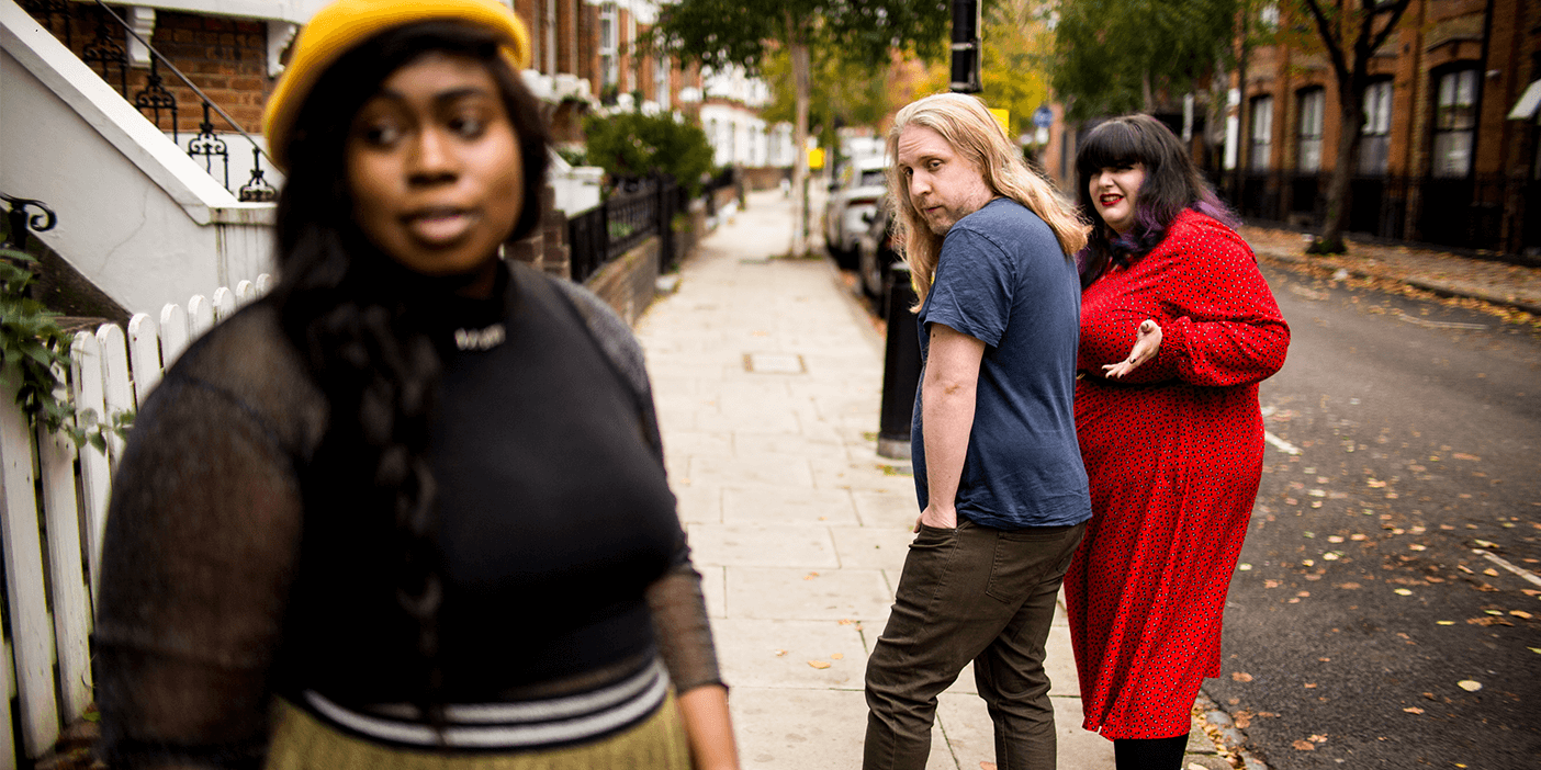 Recreation of the distracted boyfriend stock photo/meme using plus-size models.