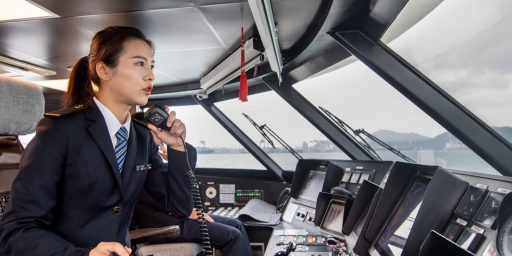 A female Second Officer sitting in the cockpit of a Chinese ship. She is very clearly in charge.