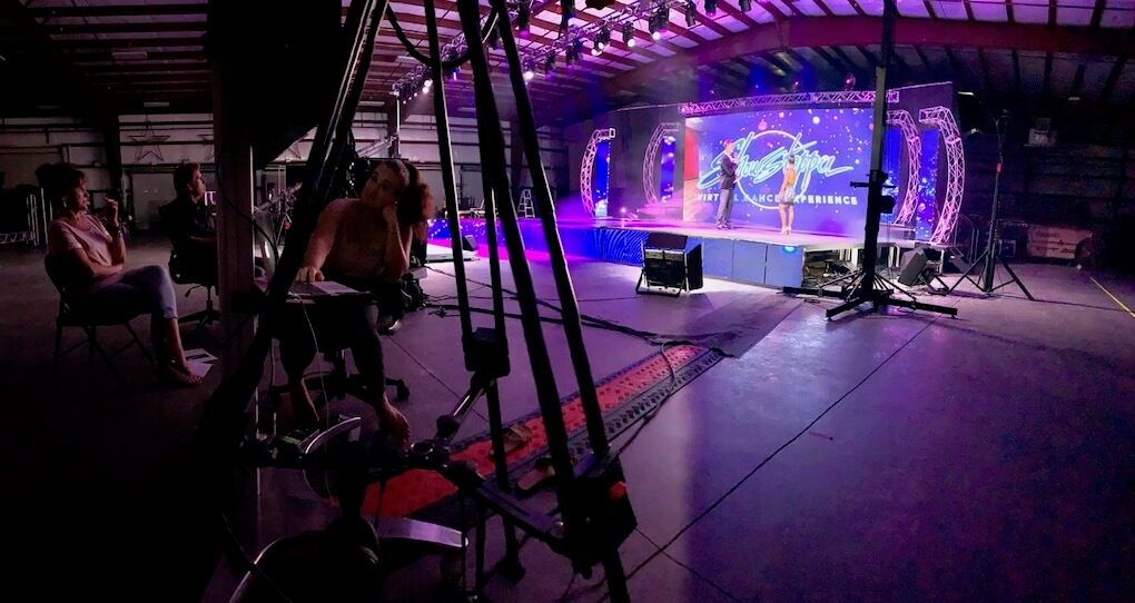 The stage set up in a warehouse at Showstopper HQ, including camera rigs and professional lighting.