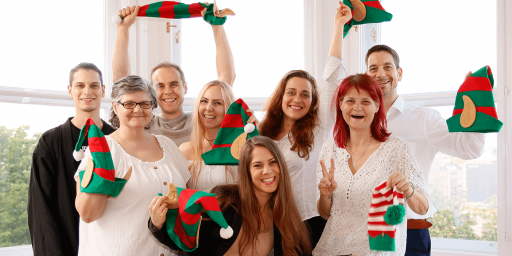 The Wichtel Challenge team posing with a bunch of elf hats.