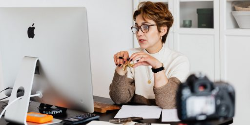 7 Best Virtual Events From 2020/21. A photo of a lady in front of a computer.