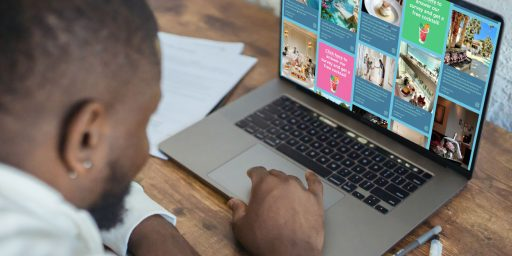 How to Use Sponsored Posts On a Social Wall. In the image: a person looking at a social wall on a laptop.