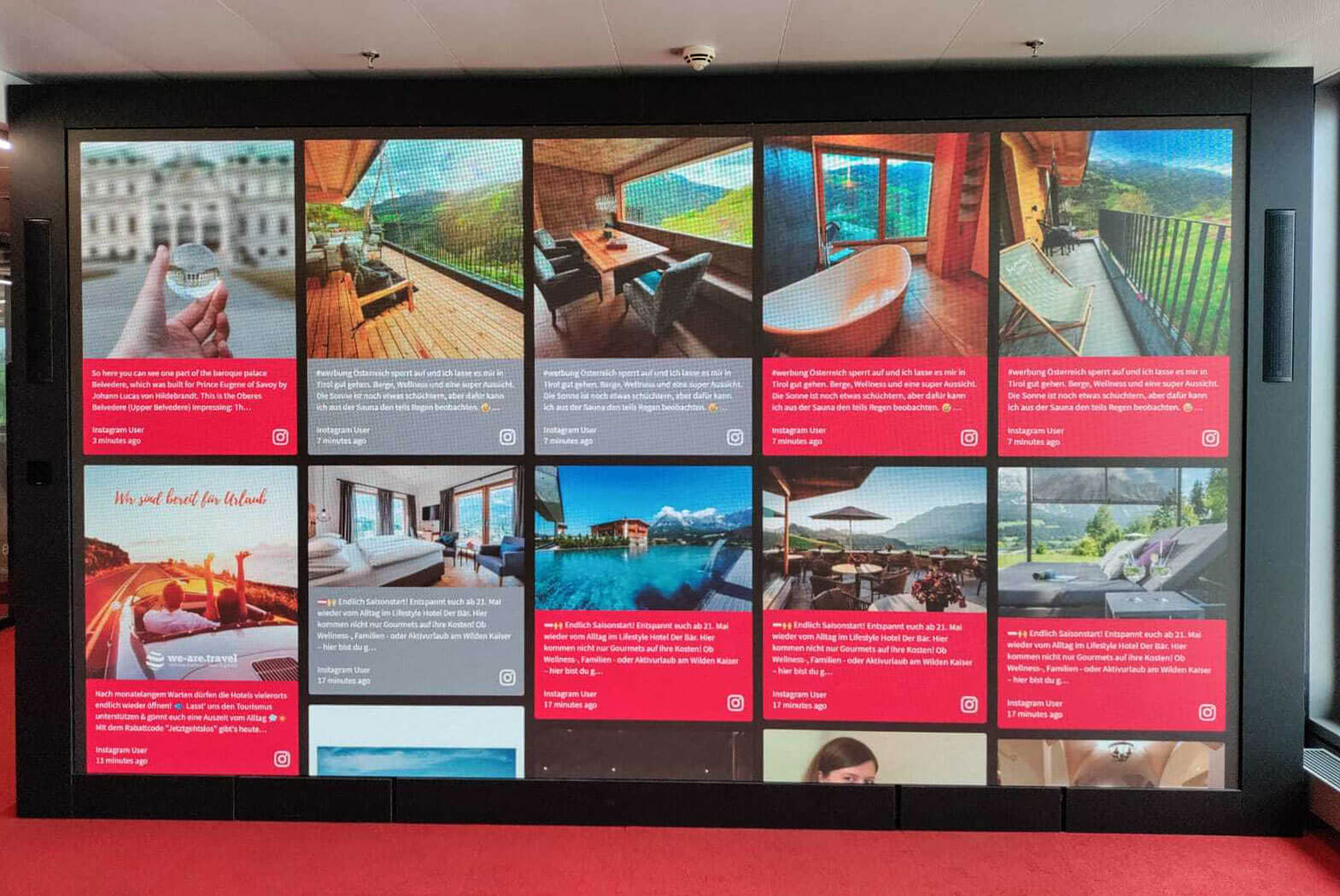 Photo of a very large LED wall that displays the Austrian Tourism social wall.