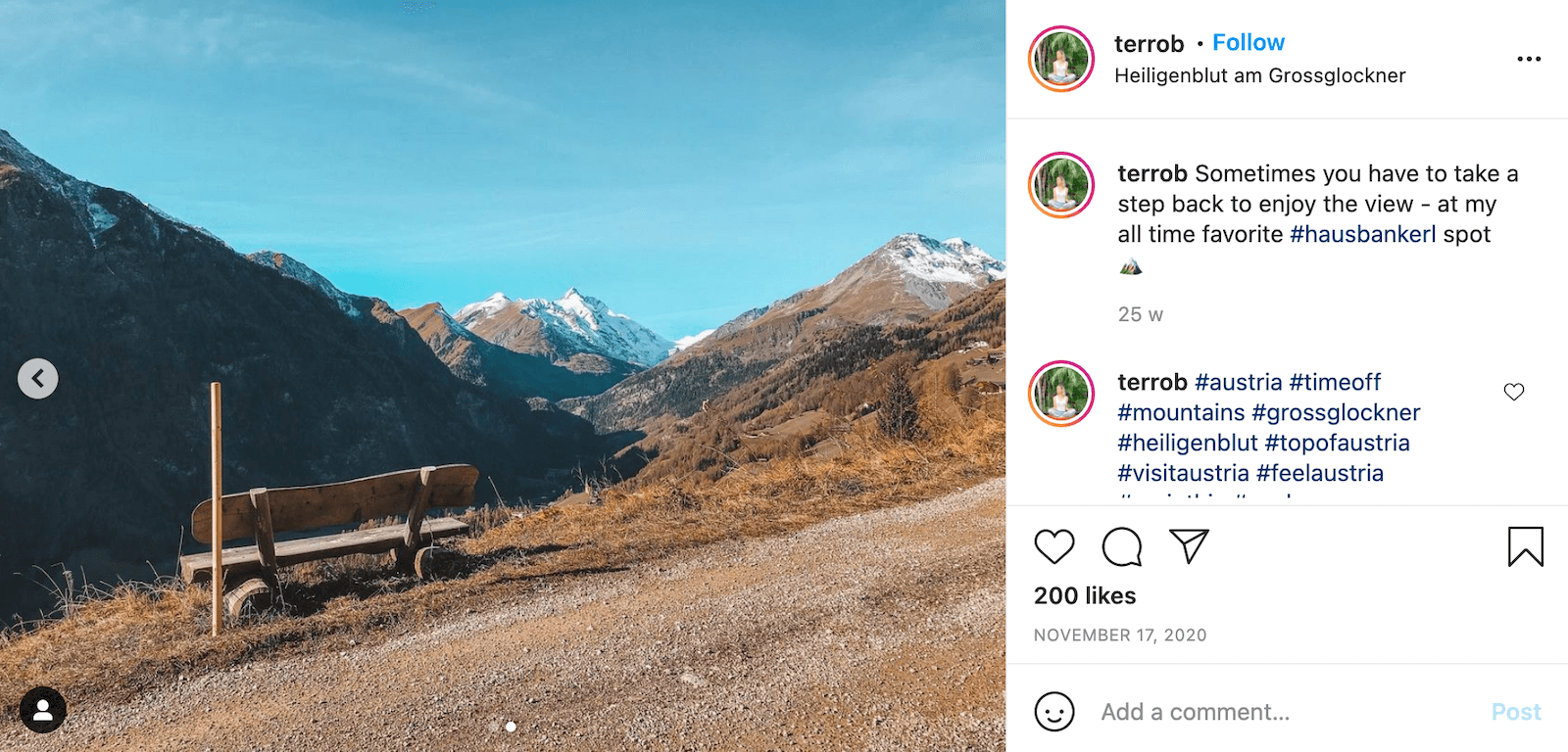 Instagram post by user @terrob showing a wooden bench on the edge of a path overlooking a mountain range. The caption says: Sometimes you have to take a step back to enjoy the view - at my all time favorite #hausbankerl spot 🏔