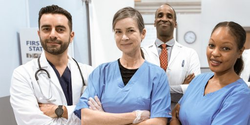 Healthcare Social Media Marketing: 5 Tips to Elevate Your Strategy. In the image: a group of doctors posing with arms crossed.