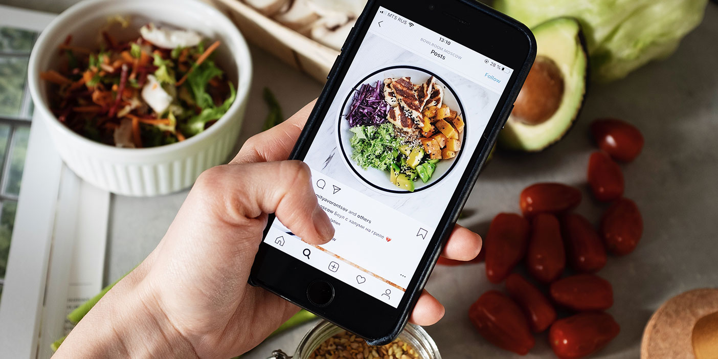 How to Make It Super Easy for People to Post to Your Social Wall. In the image: a phone showing an instagram post of a salad.