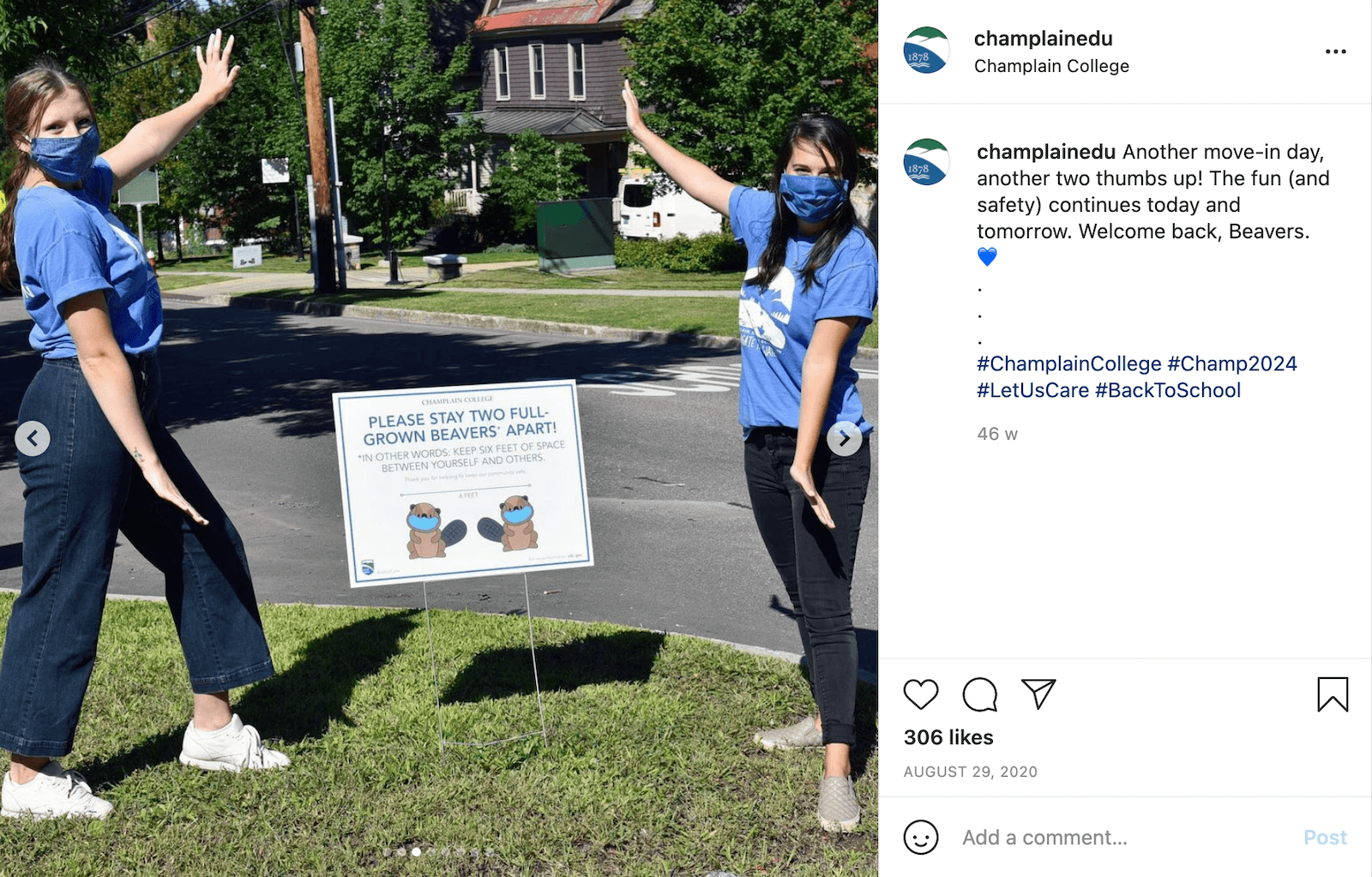 """Instagram post by champlainedu showing to students posing with a lawn sign that reads, """"Please stay two full-grown beavers apart!"""" and is illustrated with two beavers, the school's mascot. The caption reads, """"Another move-in day, another two thumbs up! The fun (and safety) continues today and tomorrow. Welcome back, Beavers. 💙"""""""