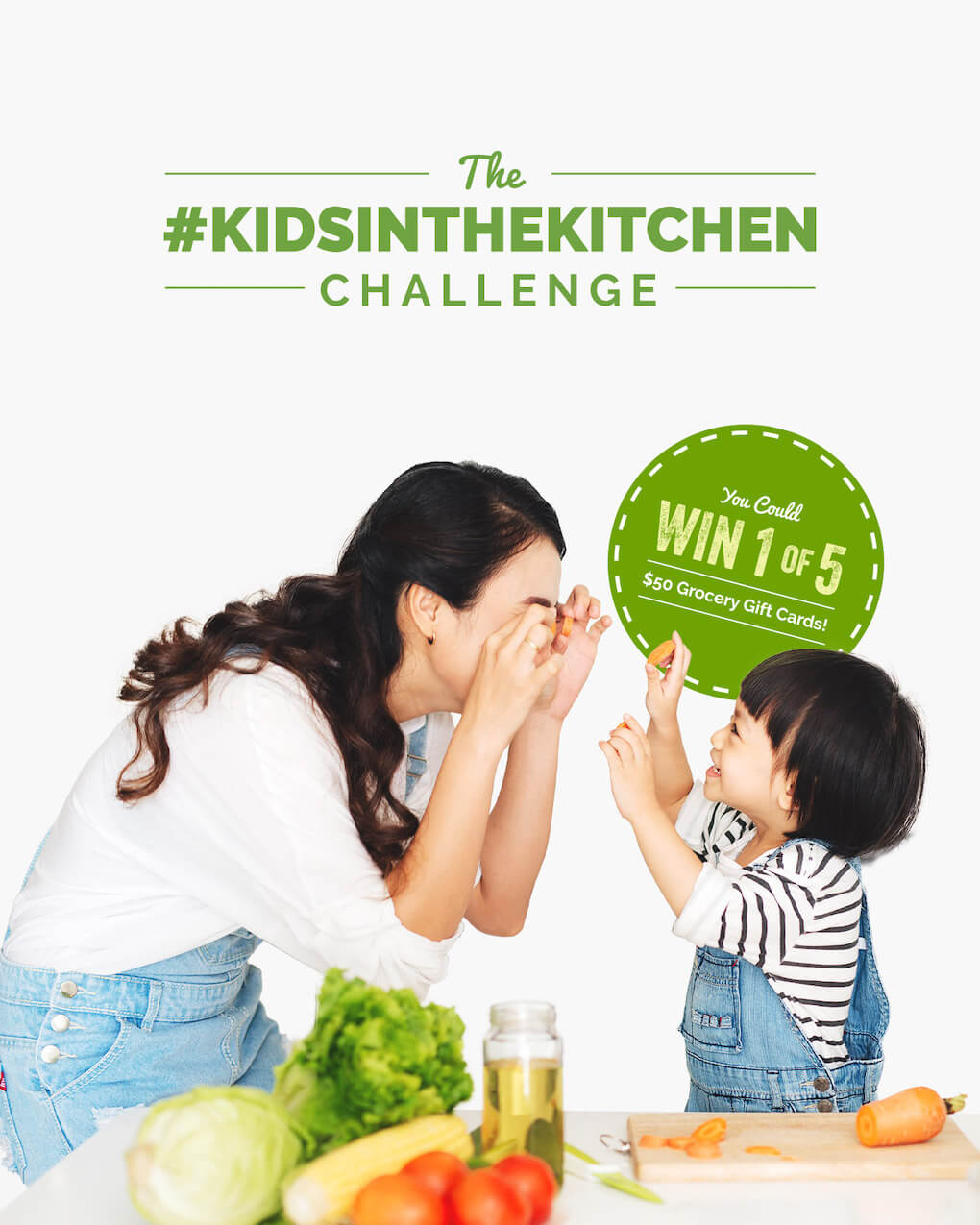 """Promotional photo for the Kids in the Kitchen campaign. An adult and a kid facing each other and goofing around. The adult is holding carrot rounds up to their eyes. The child is laughing. They're standing behind a table with vegetables, a chopping board with half a chopped carrot and a jar of oil placed on it. There's a round sticker placed on the photo saying """"You could win one of 5 $50 Grocery Gift Cards""""."""