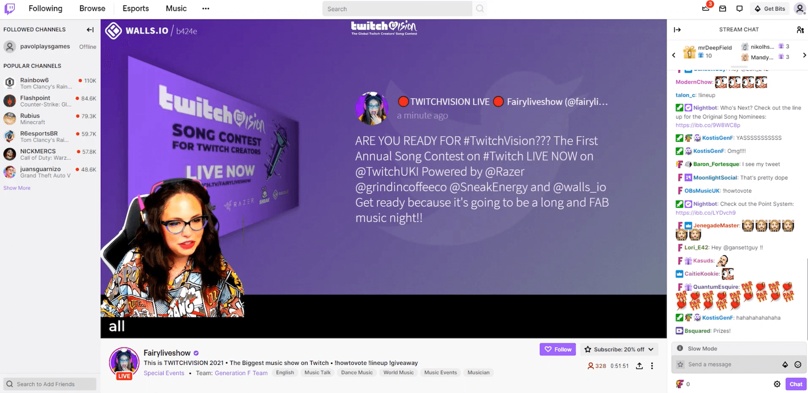 Screenshot from the TwitchVision live-stream with the broadcast showing in the middle and the very active chat pane on the right-hand side. On the stream, Marili is presenting a post from the social wall which is projected on the screen behind her.