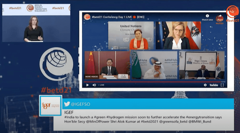 The image shows the event website for the Berlin Energy Transition Dialogue. Under the live-stream, a tweet is prominently displayed.