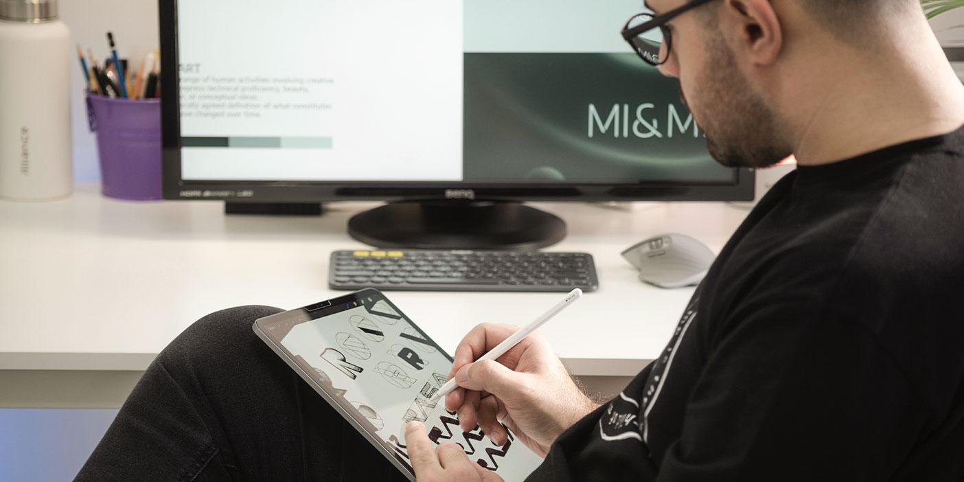 Designer drawing on an iPad.