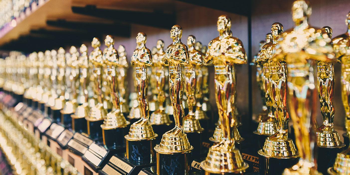 Photo of many golden awards.